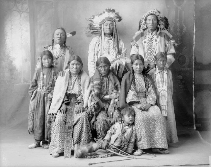 Standing L-R: The Man, Red Dog, Yellow Boy Sitting L-R: Fierce Woman, Old Woman, Good Road Girl - Assiniboine - 1898