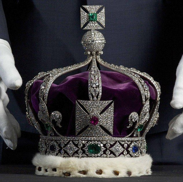 The Imperial State Crown of India, which contains over 6000 diamonds, is prepared for the new exhibition of the Crown Jewels at the Tower of London.