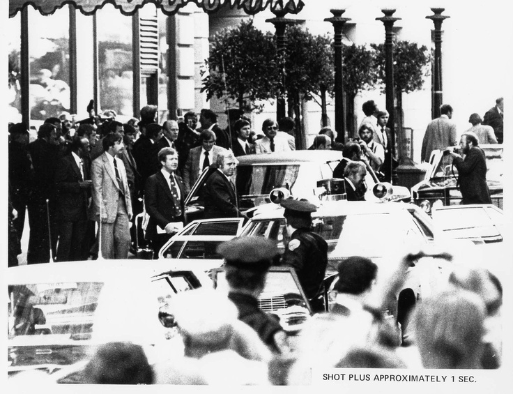 Reaction of Secret Service agents, police, and bystanders approximately one second after Sara Jane Moore attempted to assassinate President Gerald R. Ford.  September 22, 1975.