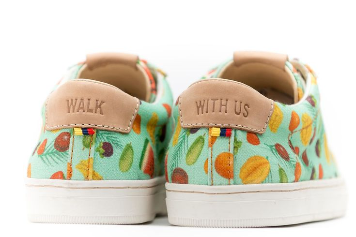 The SYOU CO.8 TROPICAL FRUITS sneaker features exotic Colombian fruits illustrated by collaborating artist Santiago Oliveros. Mint green canvas. Get yours at SYOU.com
