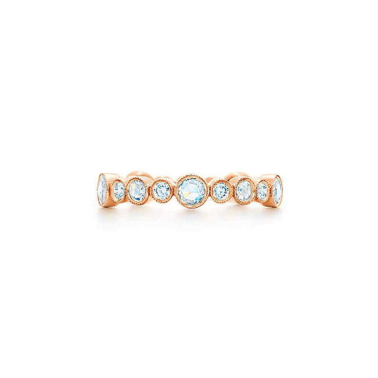 TIFFANY COBBLESTONE Diamond Band Ring. 18k rose gold setting allows alternating sizes & cuts of glittering diamonds to take center stage. Rose-cut & round brilliant diamonds, carat total weight .74.