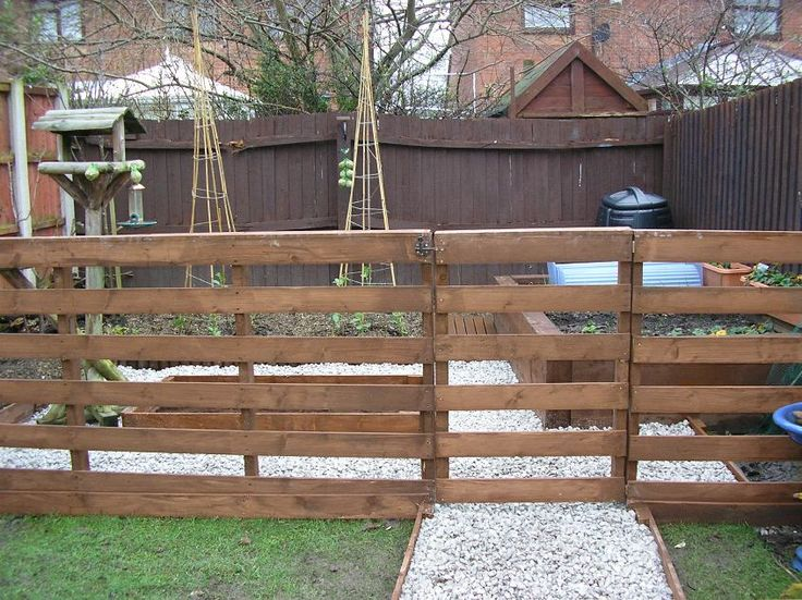Wooden pallet fence, raised beds and walkway edging.
