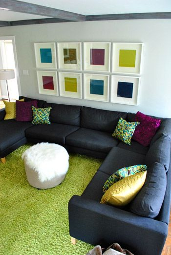 This could be part of my second, modern living room... a black couch with crazy pillows! Minus the hideous green rug!