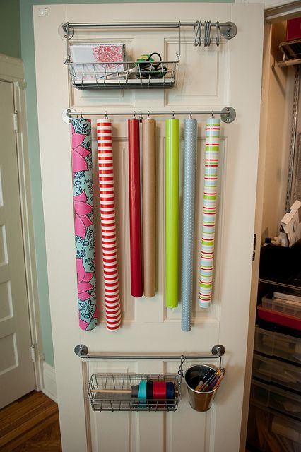 Hang paper side-by-side on a towel bar so you never have to dig through the Christmas patterns to get to the birthday roll.