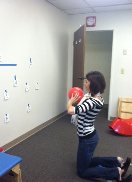 letter toss game - working on balance, visual motor control and letter recognition; also great for visual scanning.