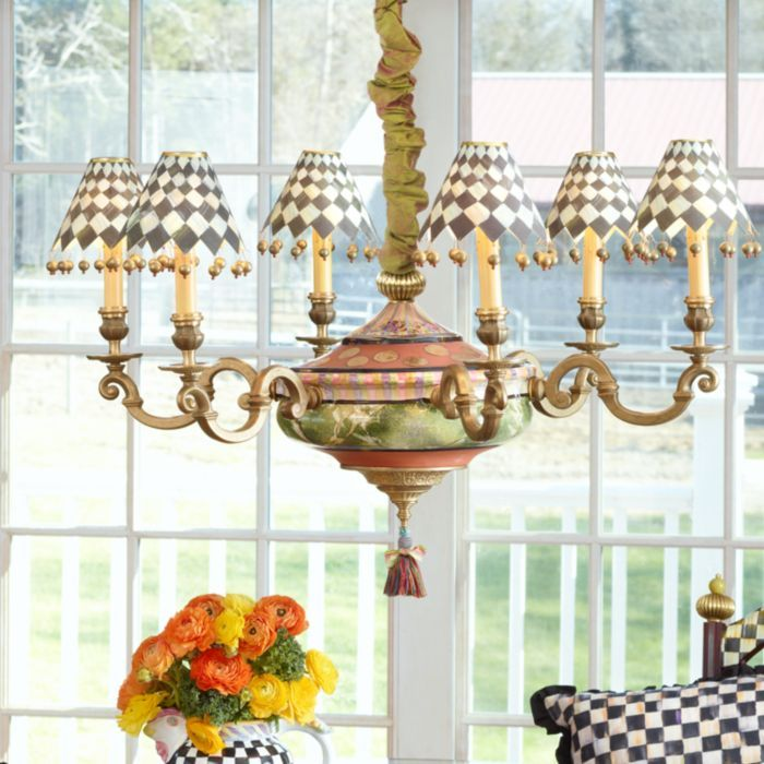 Impressive presence and impeccable design-we've really outdone ourselves this time. Our Grandolier Chandelier deftly defines a space and shines at center stage. The sweeping silhouette is crafted of clay and hand-painted with faux marbling, vivid striping, and gold lustre. Six graceful arms of cast brass support antiqued candle-sleeve columns complete with drips. This grand fixture features a multicolored tea tassel and harlequin paper shades with brass and jasper beads. Perfect in a formal…
