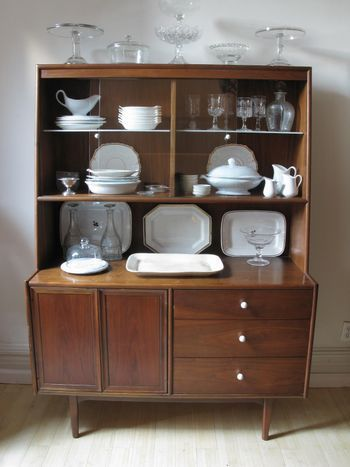 1940s Vintage Hutch with vintage plates, serving ware, and silverware.