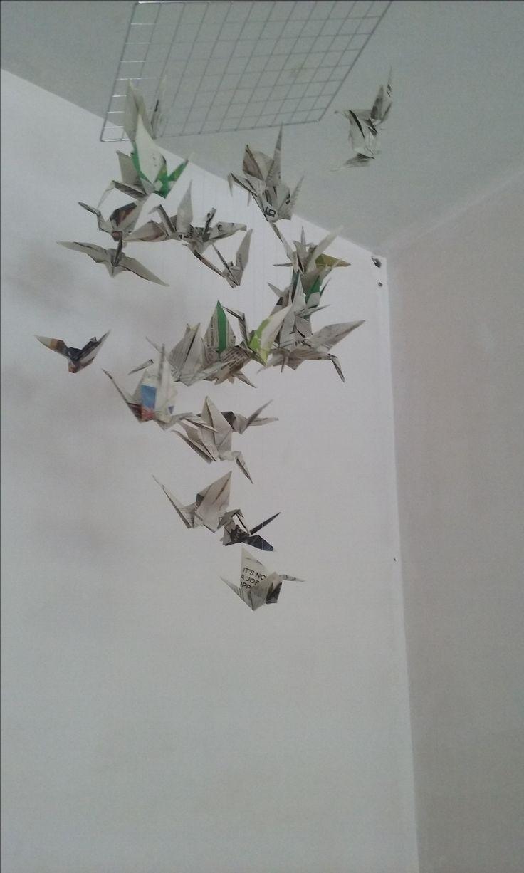 Newspaper origami crane hanging decoration.