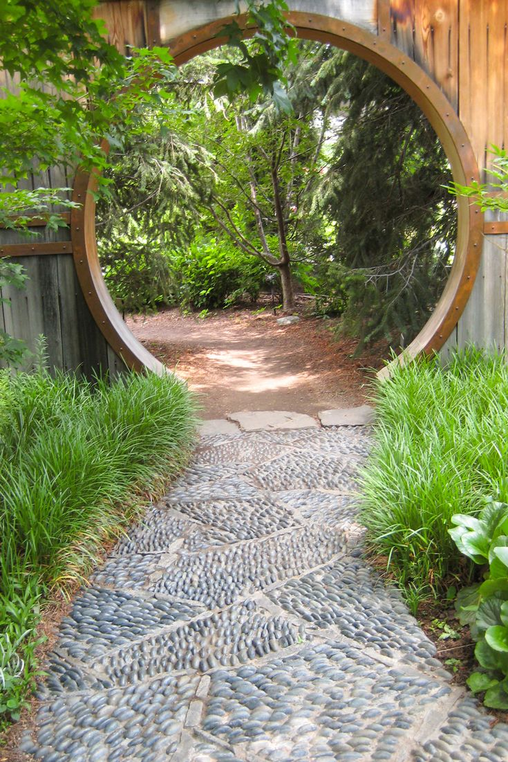 Something to think about.... at the junction between the kitchen and the garden break up the yard into two- this will make it feel bigger and wider. How about walking through a porthole!