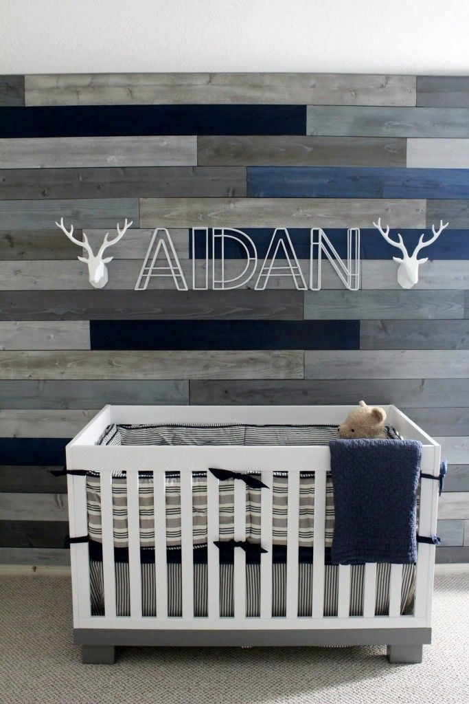 babyletto Modo spotted on Project Nursery - Gray and Blue Pallet Wall in this Modern Navy & Grey Rustic Nursery