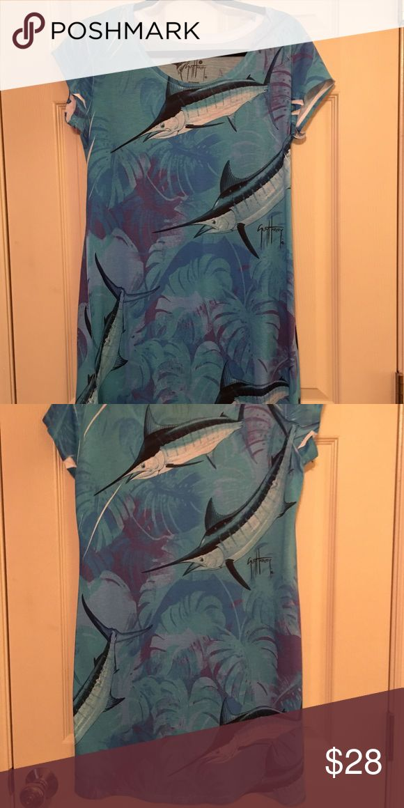 Guy Harvey marlin cotton tee shirt dress Medium Guy Harvey super comfy, lightweight, cute tee shirt dress. Beautiful signature Guy Harvey marlin print all over. PERFECT, easy, throw on and go dress. 100% super soft polyester. Perfect condition. No signs of wear. Size medium. Smoke free home. guy harvey Dresses Mini
