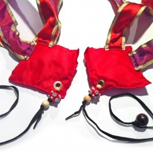 Poi – Royal  Royal Poi -Red bean bag Poi with red and blue ribbons and black lace handles and wood bead handles.