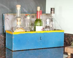 Booze Box | Yellow Brick Home ~ repurposed metal tool box -- would be cute in the kitchen for cooking sauces/oils, too