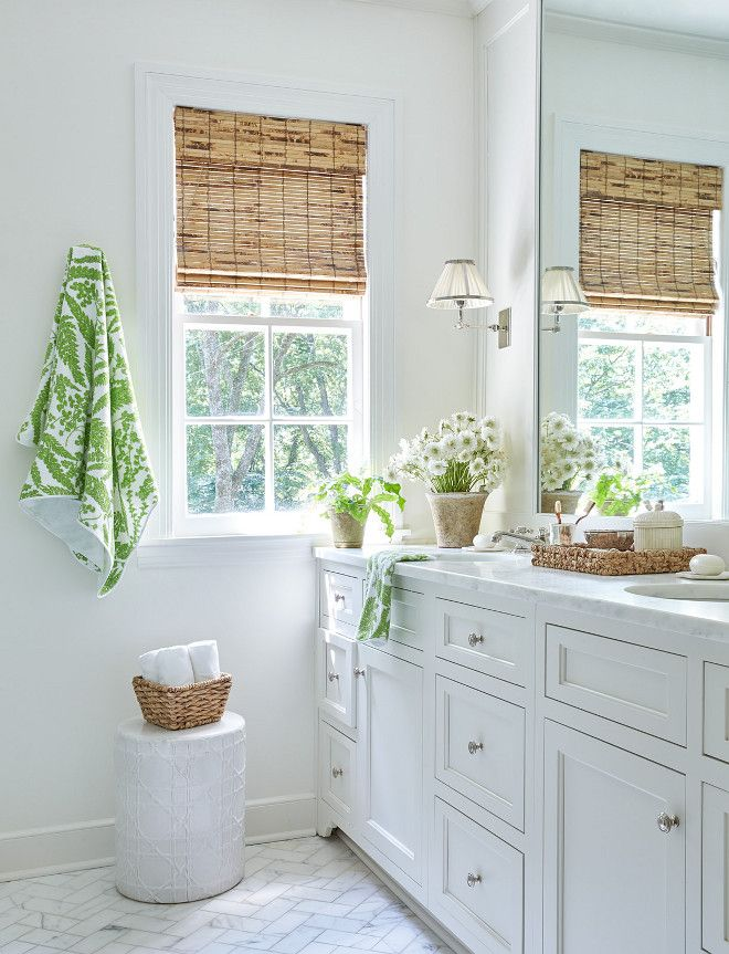 Green And Natural Touches In An All White Bathroom.