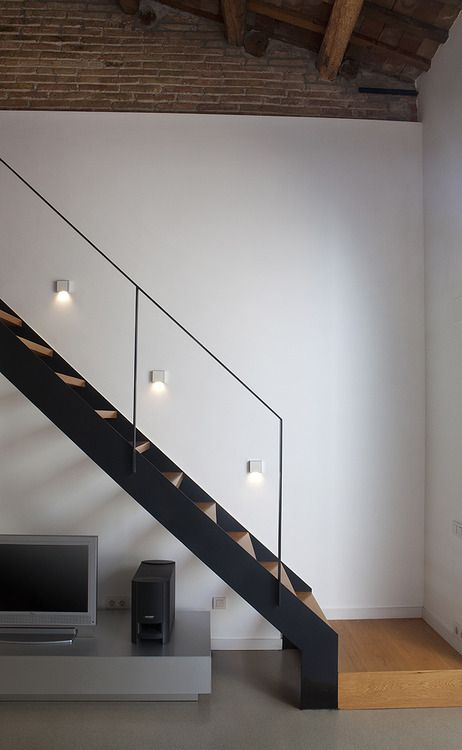 Steel stairs, timber treads and glass railing - for the storey 1/2 side of the house.
