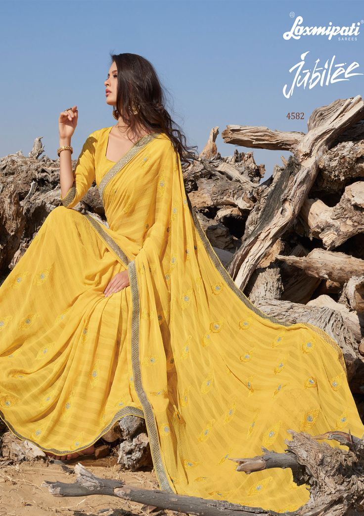 Explore this awesome Pink Yellow #Chiffon #Embroiderystone Work #Saree and Yellow Satin Silk Blouse along with Zari Lace Border from #Laxmiaptisarees. Catalogue- Jubilee, Design Number: 4582, Price: ₹ 2658.00 #Jubilee0417