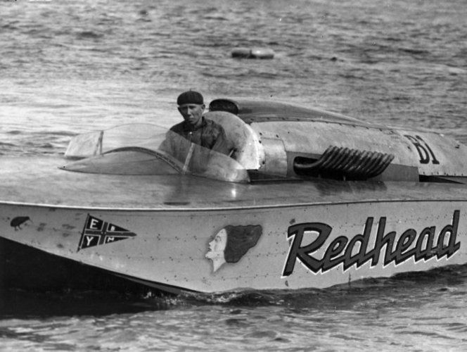 "Len Southward driving Redhead, the first boat in New Zealand to ""crack the ton"" (exceed 100 mph)."