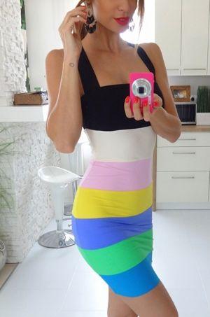Krásne letné šaty pestrých farieb s hrubými ramienkami prekríženými v zadnej časti. Vhodné na párty či na spoločenskú udalosť.