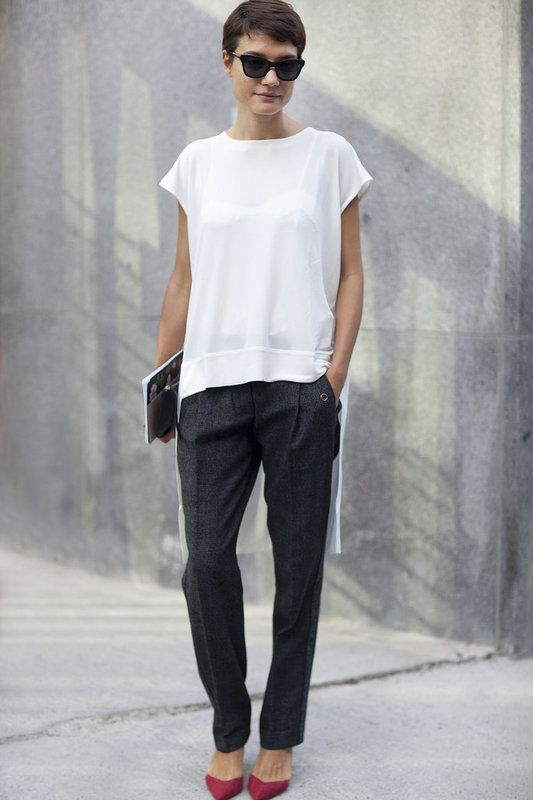 Vogue Turkey's director Konca Aykan with the Fashion Spot in a very  minimalist ensemble: pleated charcoals trousers, white top with exaggerated  hi-low hem, ...