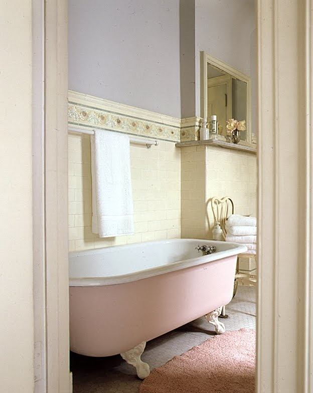 The pink and blue in the bathroom-tile frieze inspired the choice of cool blue-gray for the walls and pale pink for the underside of the tub -- much less harsh than porcelain white.