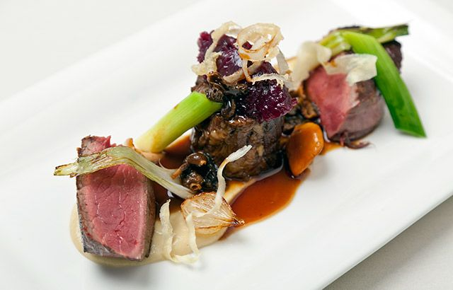 Fillet of beef with braised oxtail, textures of onion and morel Madeira sauce - Simon Haigh