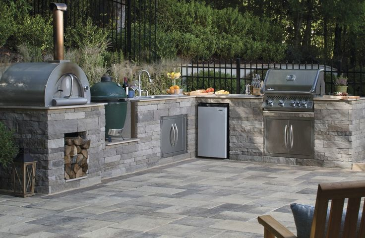Today's outdoor chef isn't happy with just a standard grill. Modern outdoor kitchen design quite often includes multiple cooking surfaces — including gas burners, gas or charcoal grills, ceramic smokers,  and wood-burning or gas ovens.