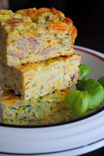 Take Another Bite: Zucchini Slice -   4 green zucchini, shredded  1 onion, minced  3 slices bacon, rind removed, sliced and cooked  1 & 1/2 cups cheddar cheese (I used 2 YO cheddar)  1 cup flour  1 teaspoon baking powder  1 teaspoon salt  1/2 teaspoon ground black pepper  5 eggs, lightly beaten