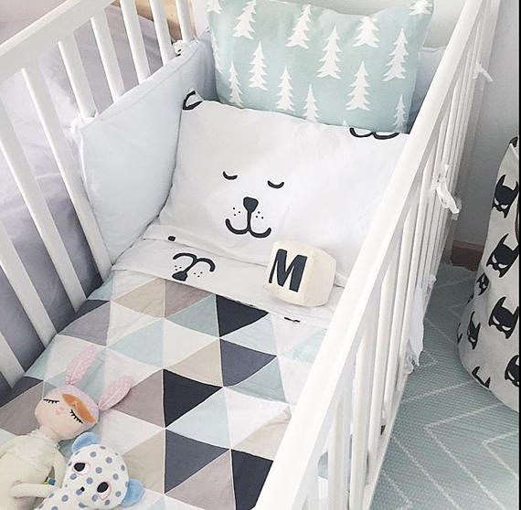 Nursery featuring a beautiful modern mint triangle fabric exclusive to NotSewStrange.