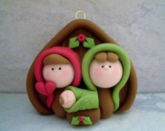 A sweet nativity ornament created from polymer clay.  This is an original and handcrafted design. The ornament measures just under 3 tall.