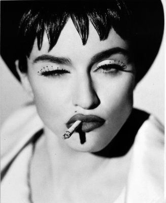 I definitely did a charcoal version of this picture in high school. I wish I were better at actually hanging onto my work. (Madonna by Herb Ritts)