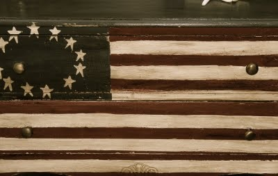 Americana! I have this hanging in my great room. Great piece. Mine is made of an old picket fence.