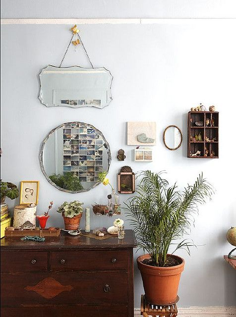 Love the mix of mirrors, and the off center arrangement is kind of interesting.  Not sure how I feel about that aspect of it!  (Love that dresser though!)
