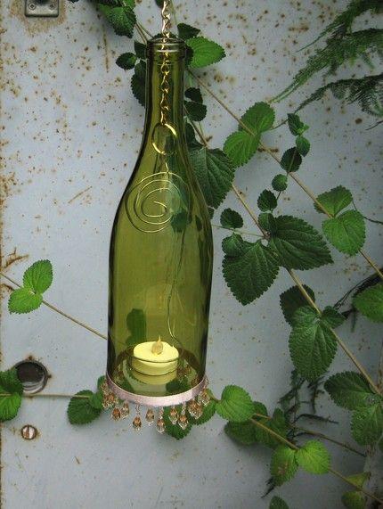 Wine bottles upcycled to decorative lanterns.