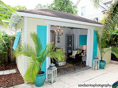 chandelier is part of this cutesy outdoor cabana - that used to be an old garage... WHAT?!?!  belle maison