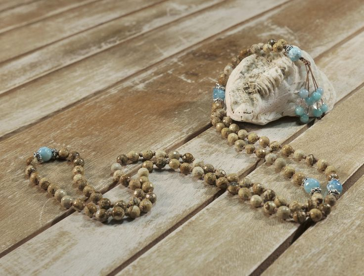 This mala necklace is crafted with 108 semi precious stones of picture agate accented by sterling (9