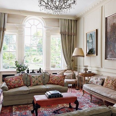 Traditional English living room in cream design by Caroline Harrowby with Colefax and Fowler fabric. Living room ideas for furniture, wallpaper, design and decor.