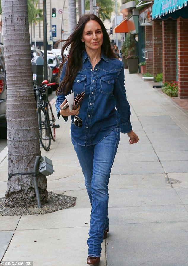 Running errands: Madeleine Stowe - sporting her signature mermaid mane - donned a double denim ensemble in Beverly Hills on Thursday
