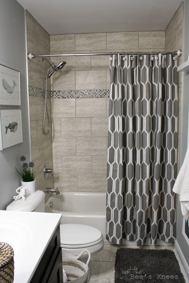 i love everything about this bathroom remodel i love the colors the cute nautical theme the chalkboard towel hooks the shower curtain - Bath Shower Tile Design Ideas