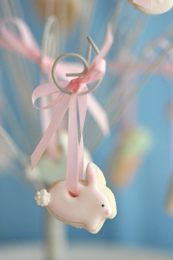 Tiny little easter cookies hanging from a wire tree - sweet!