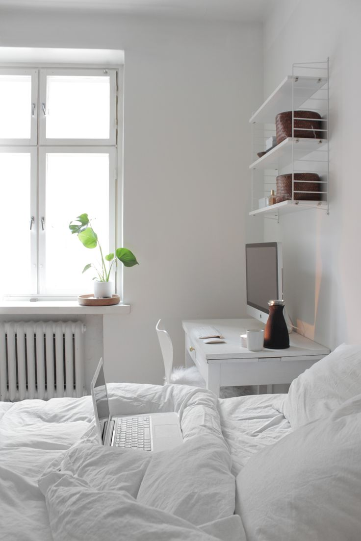 Keep it all in white in the bedroom, when there's no room for a desk elsewhere