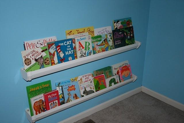 Rain Gutter Bookshelves...such an awesome space saver idea!