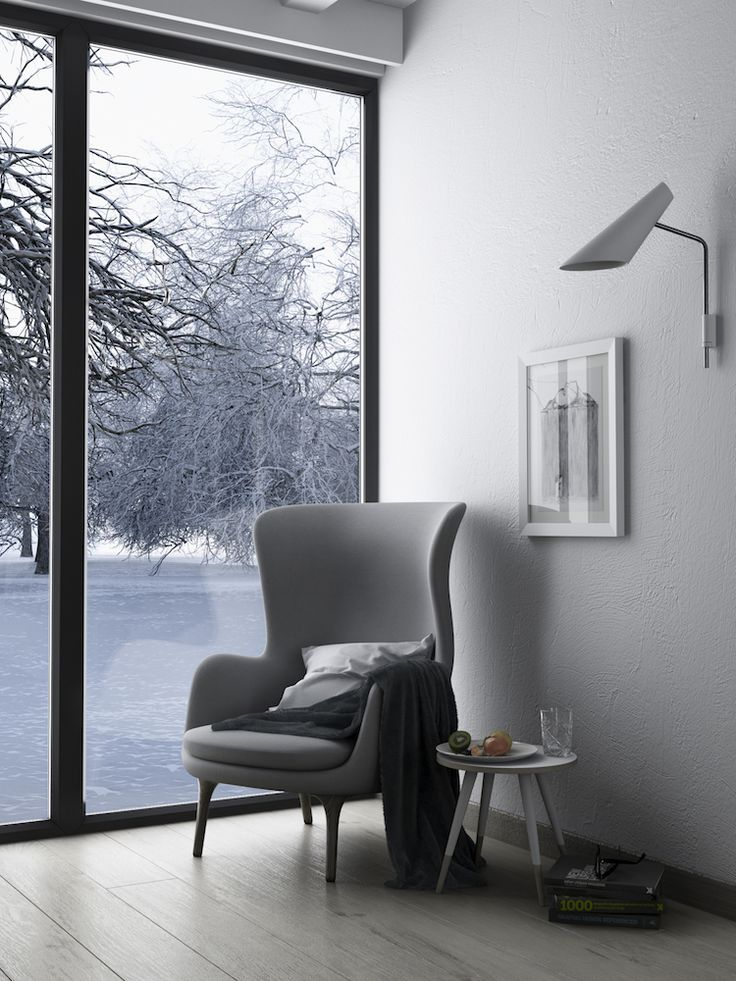What a contemporary armchair for your living room. The grey fabric matches perfectly with the wood legs.