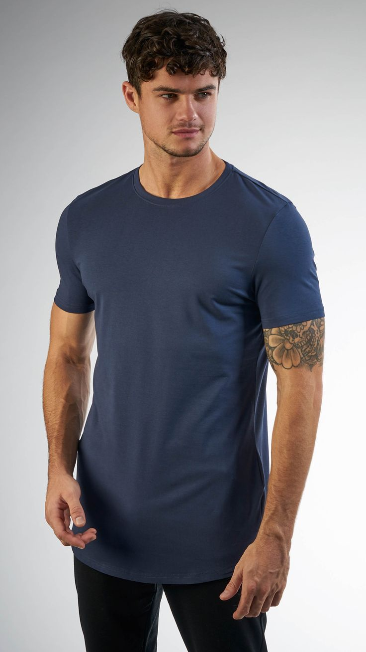 Perfect your workout wardrobe with the Men's Solace Short Sleeve T-shirt. -  Dipped hem- Tonal logo - Longline fit polyester, elastane Model is and  wears ...