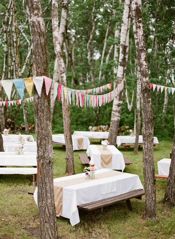 Love the pennants hung throughout the picnic tables. Easy and affordable decor for a grad party!