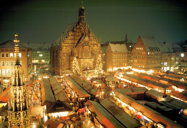 The Nürnberg Christkindlmarkt lining Hauptmarkt Square is also known as the 'Little Town of Wood and Cloth' due to its vibrant red and white ribbons decorating more than 200 Alpine chalets. Photo: WikiMedia.org.