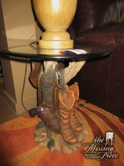 """Glass top end table on cowboy boots base. What an interesting find! Measures 21""""round x 22""""high. Super fun western piece! At posting, we have a pair of these."""