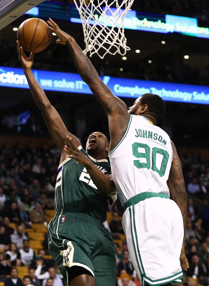 Amir Johnson #90 of the Boston Celtics blocks a shot by Khris Middleton #22 of the Milwaukee Bucks during the first quarter at TD Garden on March 29, 2017 in Boston, Massachusetts. NOTE TO USER: User expressly acknowledges and agrees that by downloading and or using this photograph, User is consenting to the terms and conditions of the Getty Images License Agreement.