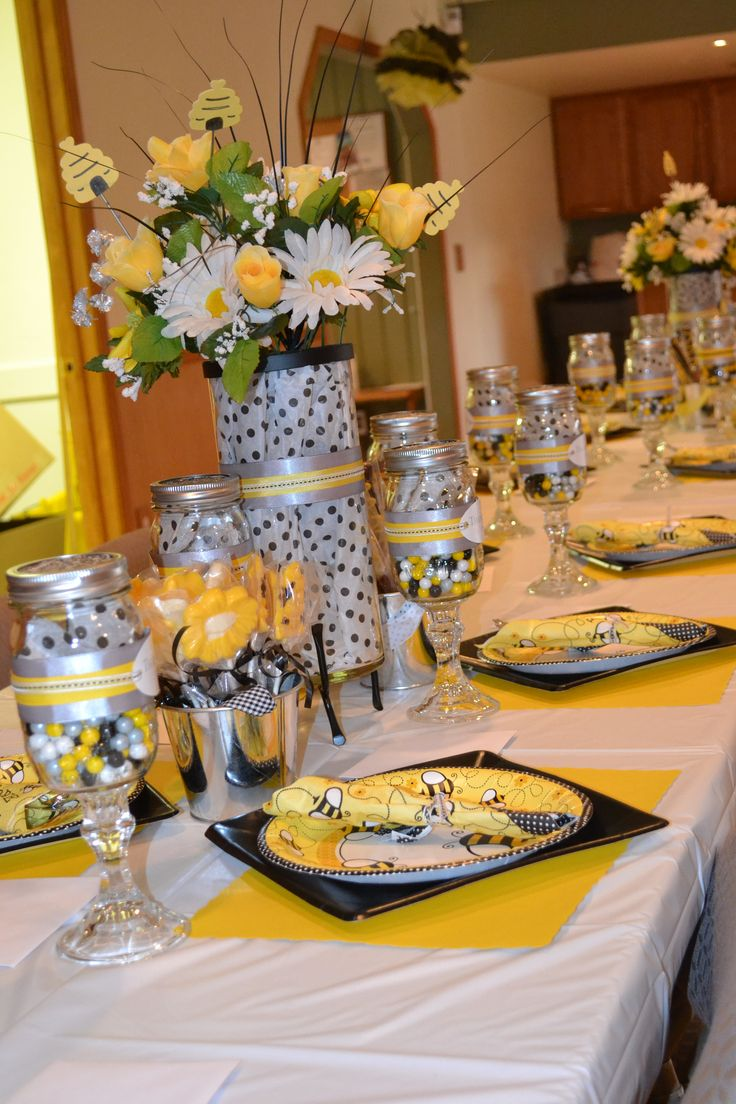 These are some fun centerpieces. I like the daises. The bee themed plates are great. What do you guys think?