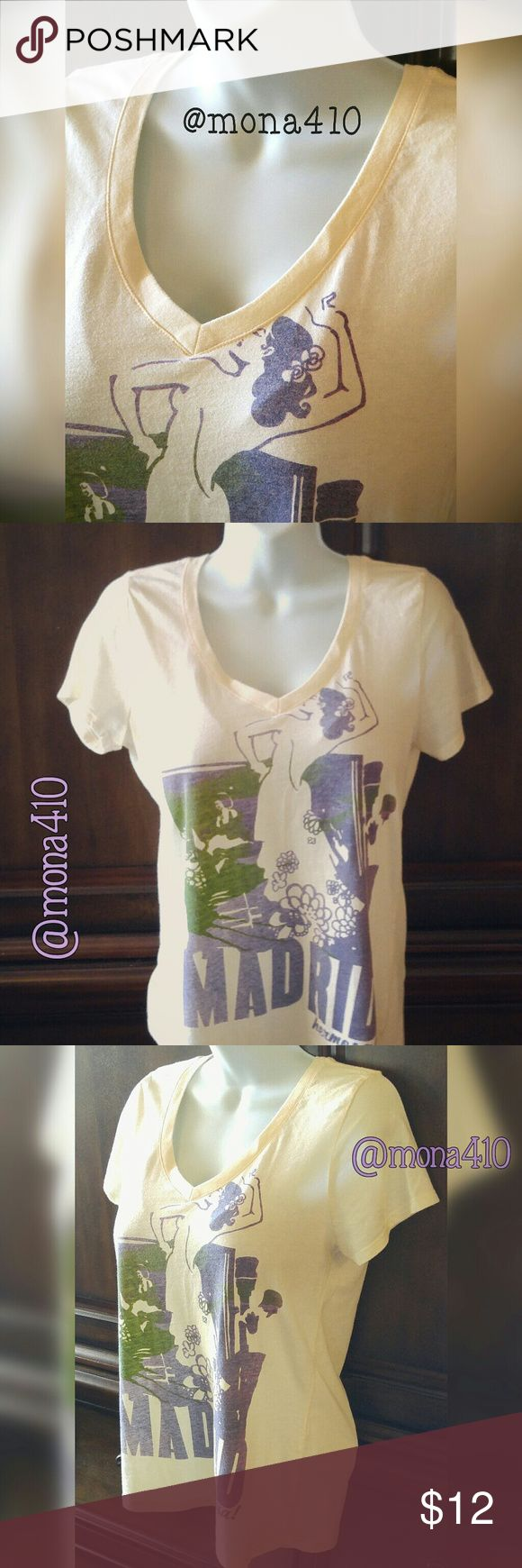🆕 List - NWOT/Old Navy V-Neck Graphic Shirt This Old Navy shirt is a light yellow, almost tan color. Very lightweight and comfortable and perfect for Summer! V-neckline, graphics are of a Latina dancer and says Madrid Hermosa. Size is Medium. Shirt is new and never worn.   ⚡Bundle & save on shipping! 15% bundles of 3 or more.  * Smoke-free home * Sorry, no trades or PayPal Old Navy Tops Tees - Short Sleeve