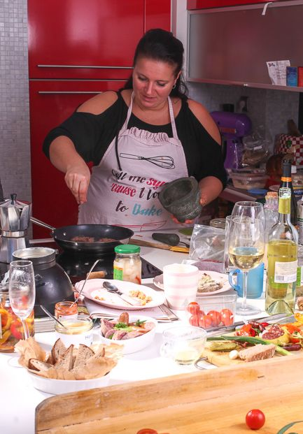 Czech chef Bara cooking in her kitchen for Travelovers - one of many fun activities in Prague.
